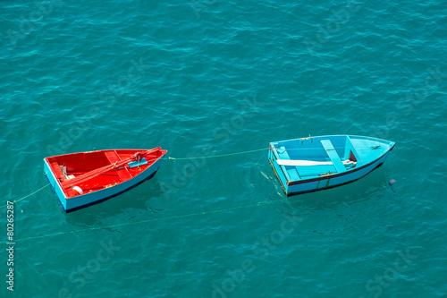 Two small fishing boats on sea, Madeira island, Portugal - 80265287