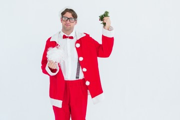 Geeky hipster in santa costume beard and mistletoe