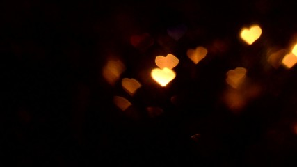 blurry colorful lights in heart shape, black background video