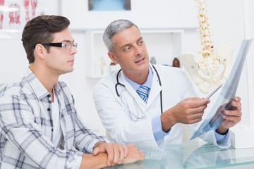Doctor showing Xrays to his patient