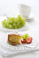 Piece of tangerine cake with fruits