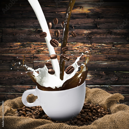 Foto op Canvas Cafe Coffee Beans Falling Into Glass of Hot Coffee Splash