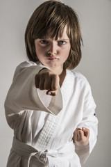 a little girl practicing karate
