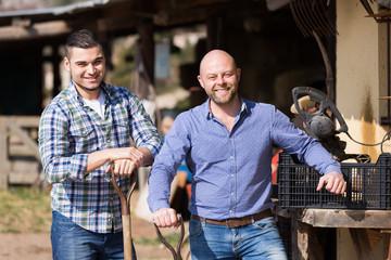 Two male farmers at farmyard