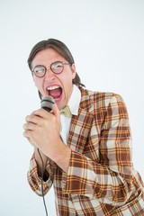 Happy geeky hipster singing with microphone