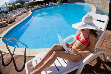 woman with laptop on resort