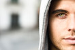 Handsome young man with blue eyes in urban background