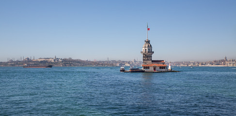 Maiden's Tower lighthouse with boats in Istanbul