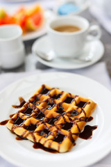 Delicious waffles with coffee