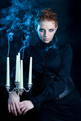 beautiful females,  girl holds a candle stand extinguished