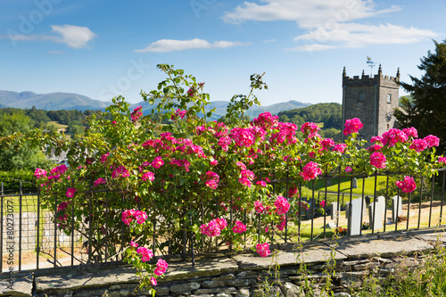 Leinwandbild Motiv Hawkshead Lake District UK pink roses and church