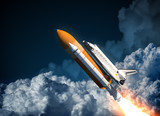 Space Shuttle Flying In The Clouds poster