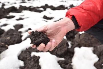 Man holding the dirt of chrenozem