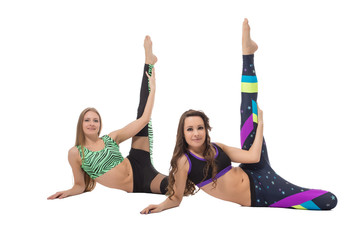 Attractive girls doing stretching exercises