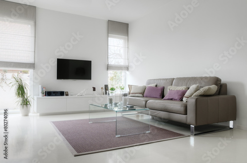 White living room with taupe leather sofa - 80274096