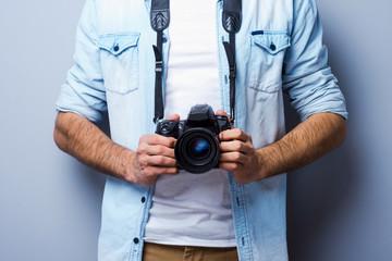Man with digital camera.