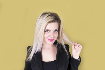 Young beautiful blonde woman (happy, yellow, background)