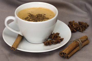 A Cup of coffee with star anise and cinnamon
