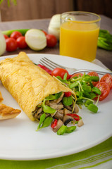 Omelette stuffed with mushrooms and microgreens