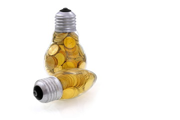 Traditional  lightbulb with  golden coins