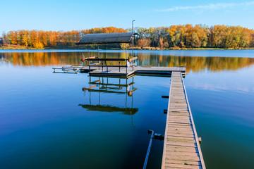 fishing dock  in a lake at  sunset