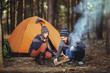 Couple tent camping in the wilderness - 80277818