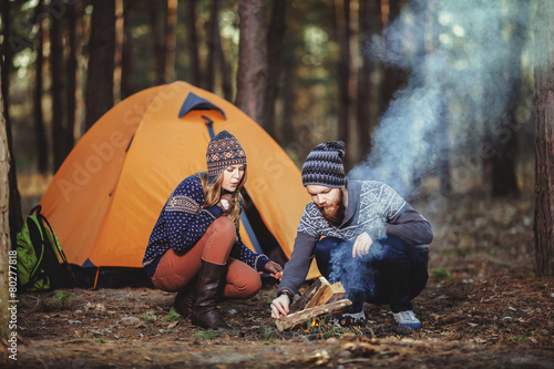 Foto op Canvas Kamperen Couple tent camping in the wilderness