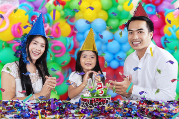 Cheerful family celebrating birthday party