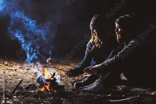 Tuinposter Kamperen Couple tent camping in the wilderness