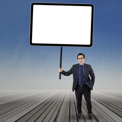 Business manager holding empty board