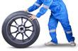 Closeup of mechanic holding tire