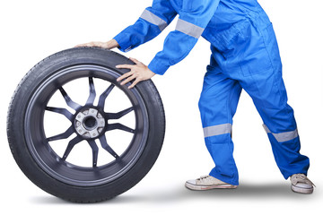 Closeup of mechanic holding tire
