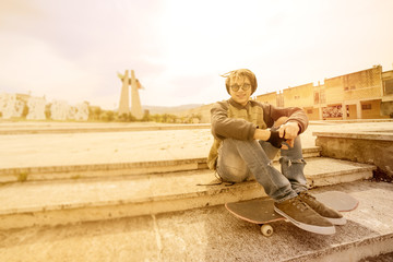 young rasta guy outdoor on skate with a warm filter applied