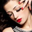 woman with creative makeup using false eyelashes