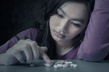 Female student with pills