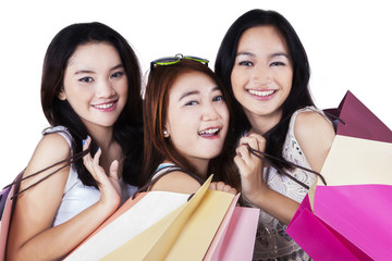 Gorgeous teenage shopaholics smiling