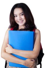 Gorgeous teenage girl with bag and folder