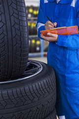 Mechanic examine the tires condition