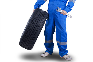 Mechanic carrying a tire and wrench