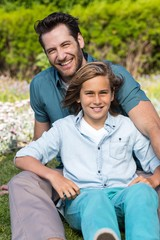 Father and son smiling at camera