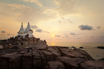 Beautiful sunset over the island with small temple silhouette