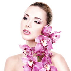 Portrait of  beautiful woman with a pink flowers