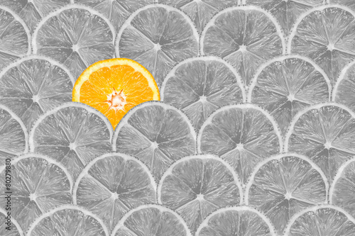 Black And White Photo Of Orange Slice Stand Out Of Lemons