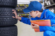 Mechanic person examining tires