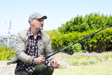 Happy man fishing