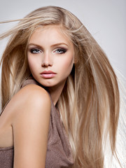 Beautiful young woman with long straight white hair