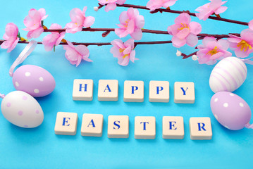 easter background with greetings and blooming tree branch