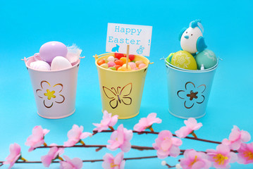 easter decoration with eggs in three buckets