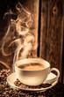 Leinwandbild Motiv Aroma coffee cup with roasted seeds