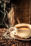 Taste cup of coffee with roasted seeds